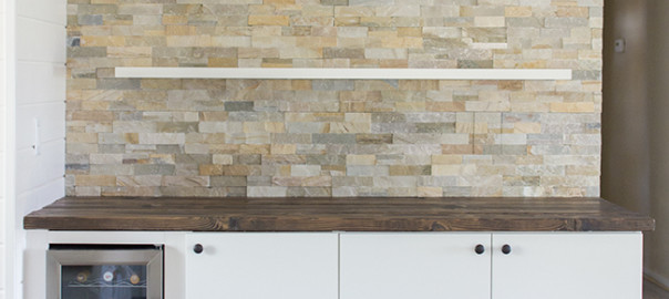Stacked stone bar wall